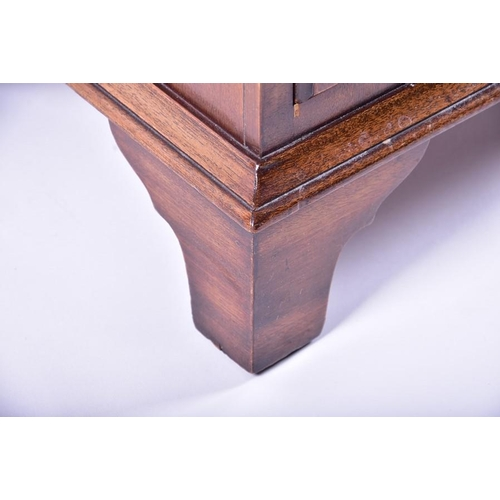 30 - A Bevan Funnell miniature apprentice narrow chest  with eight drawers on bracket feet, 76.5 cm high ...