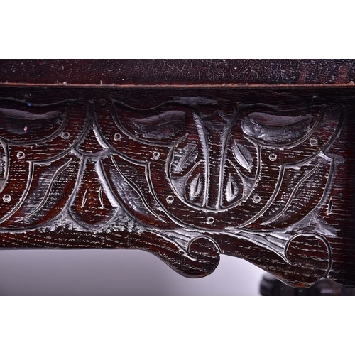 32 - A 19th century oak refectory dining table  with carved frieze and stretchers, on turned and block su...
