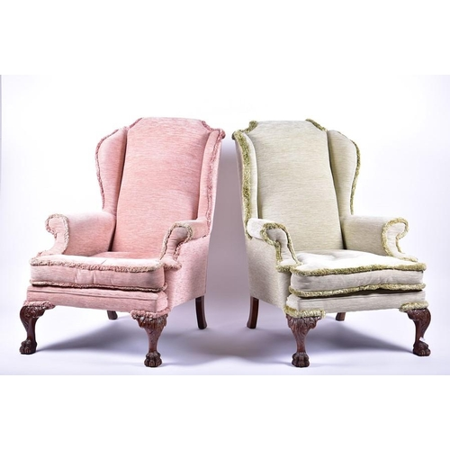 33 - A pair of Georgian style mahogany wing armchairs  in pink and green upholstery, with lion paw front ...