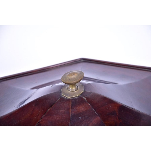 41 - A Regency mahogany veneered cellarette  designed with faceted octagonal edges and a domed top, with ...