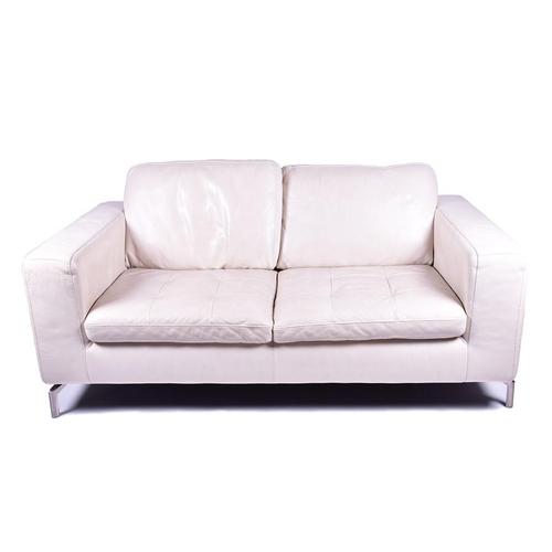 5 - A cream leather Natuzzi two-seater sofa  on four chrome feet, 172 cm x 63 cm high, the seats 66 cm d...