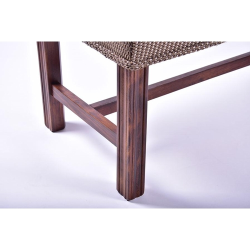 52 - A Georgian style upholstered footstool  of long rectangular form, on four reeded square shaped legs,...
