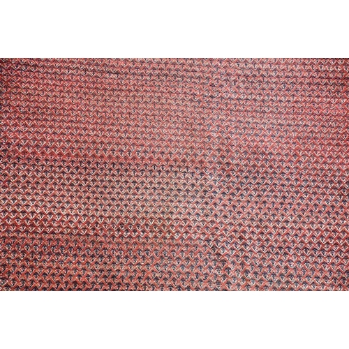60 - A large 20th century machine woven Iranian room carpet  typically decorated with repeating geometric...