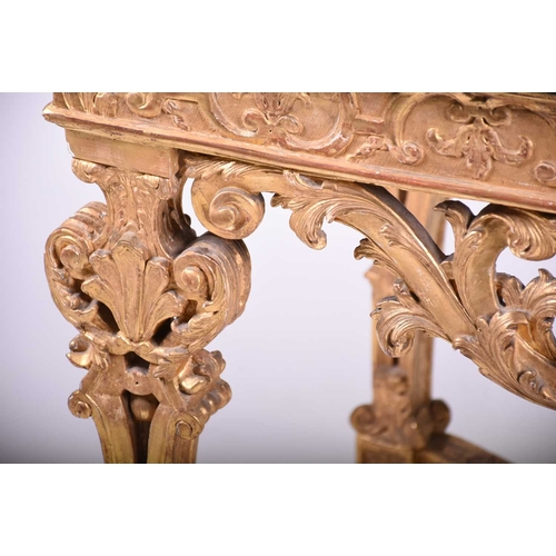 56 - A Louis XIV giltwood and gesso side table the rectangular portor marble top above a strapwork frieze...