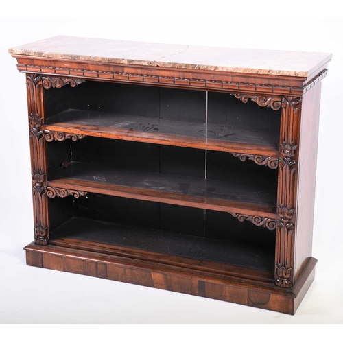 57 - A Regency rosewood marble-topped open bookcase with carved border decoration and scroll corners, on ...