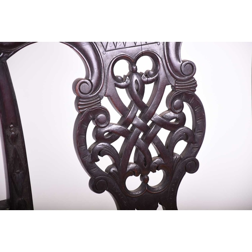 58 - A pair of Georgian style mahogany elbow chairs, with carved and pierced back splats, yellow fabric o...