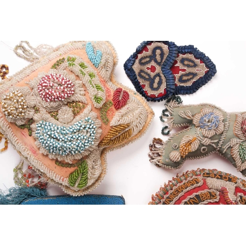 31 - A quantity of 19th-century hand-worked beadwork items to include various British and American 'Sweet...