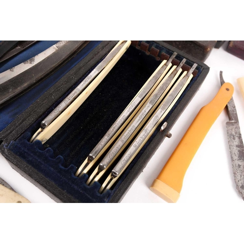 33 - A collection of 19th and early-20th century cutthroat razors. To include a part-complete 'Days of th...