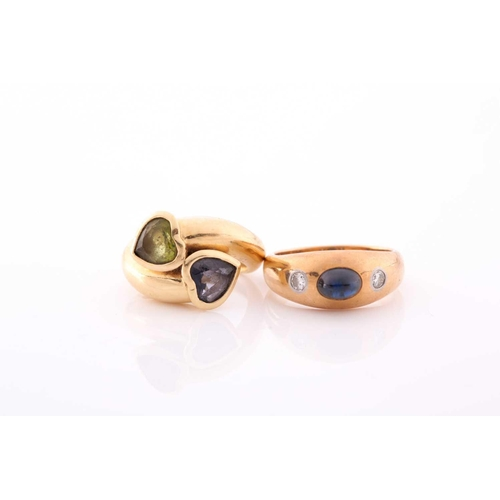 10 - An 18ct yellow gold gypsy ring, set with a cabochon sapphire and two small diamonds, size M, togethe...