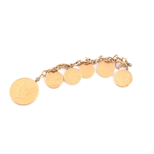 11 - A yellow metal bracelet, suspended with six various fine gold coins, including an American 20 dollar...