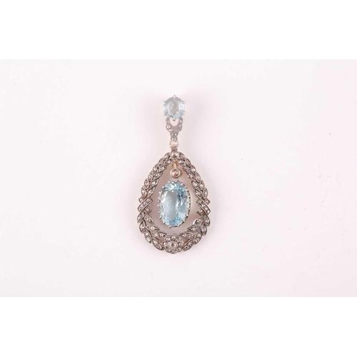 14 - A diamond and aquamarine pendant, set with a claw-mounted mixed oval-cut aquamarine, within a diamon...