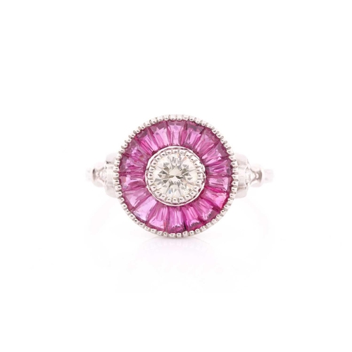 16 - A diamond and ruby target ring, in the Art Deco style, centred with a round brilliant-cut diamond, o...