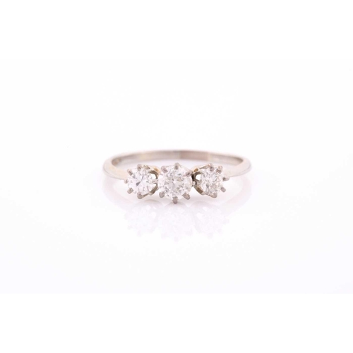 20 - An 18ct white gold and diamond ring, set with three old-cut diamonds of approximately 0.70 carats co...