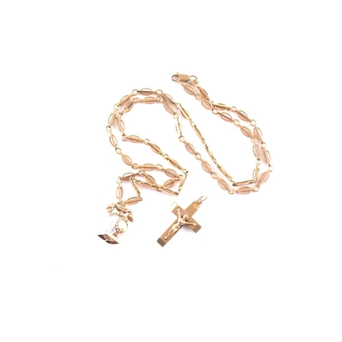 21 - A 9ct yellow gold fancy-link chain necklace, approximately 64 cm long, suspended with a yellow metal...