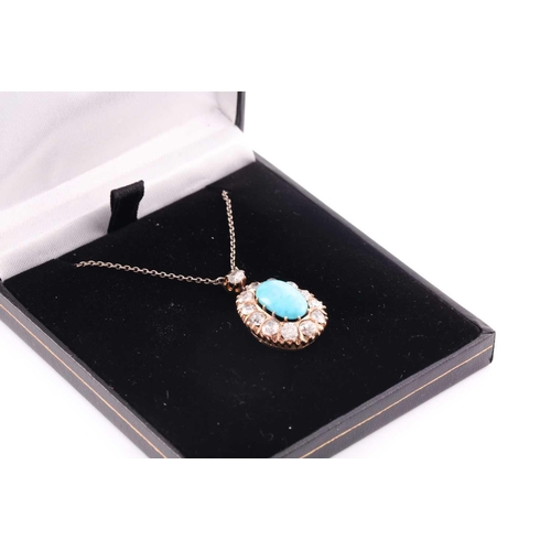 22 - A diamond and turquoise cluster pendant, set with an oval turquoise plaque, surrounded with old-cut ...
