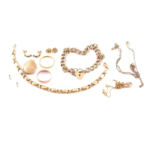 24 - A 22ct gold wedding band; together with a 9ct gold wedding band; two chain link bracelets and a smal...