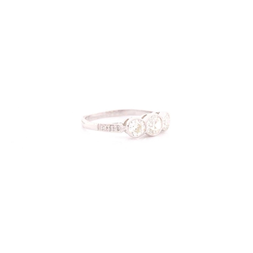 27 - A platinum and diamond ring, collet-set with three old round-cut diamonds of approximately 1.35 cara...