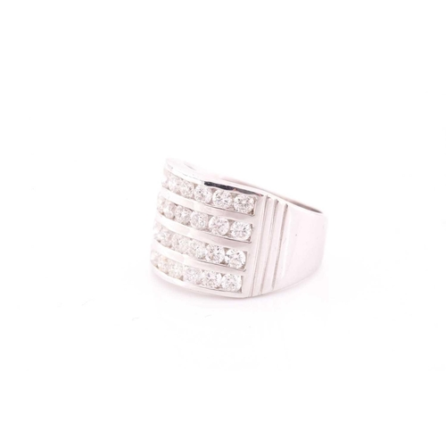 29 - A diamond band ring, channel-set with four rows of round brilliant-cut diamonds of approximately 2.2...