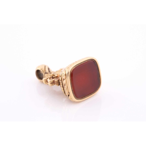 3 - A yellow metal and red agate fob seal, with concealed locket, hinged base, unmarked (tests as 15ct g...