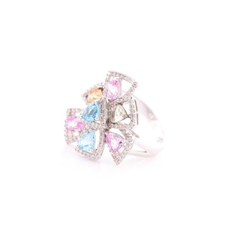30 - An 18ct white gold, diamond, and multi-coloured topaz ring of geometric floral form, the openwork mo...