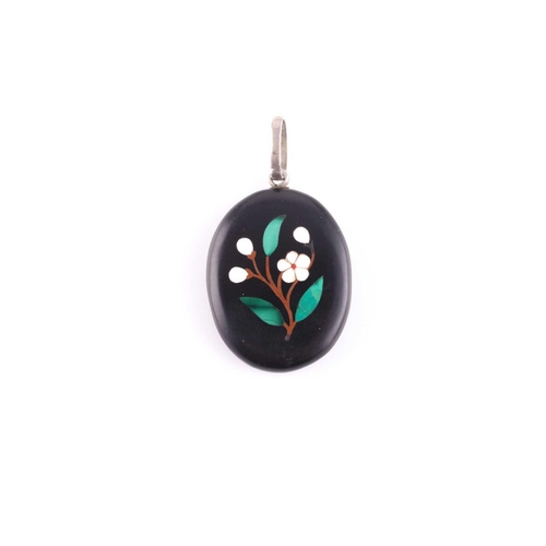 32 - A silver and black hardstone pendant locket, the back inset with a pietra dura design of a flower wi...
