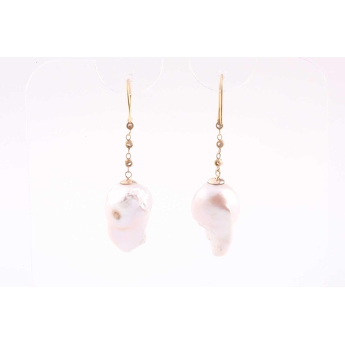 33 - A pair of Baroque pearl and diamond drop earrings, the pearls drill mounted beneath a chain of three...
