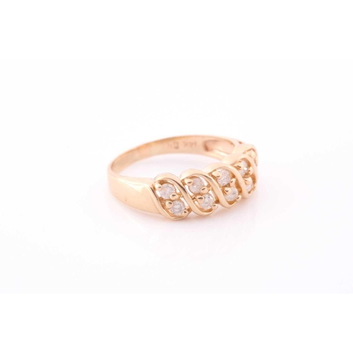 34 - A yellow metal and diamond ring set with two rows of round-cut diamonds of approximately 0.50 carats...