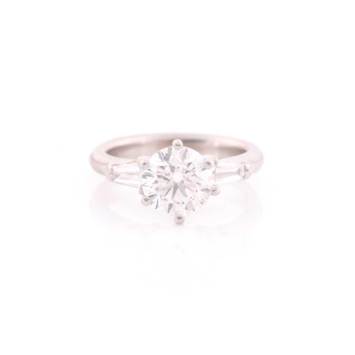 36 - A platinum and diamond ring, set with a round brilliant-cut diamond of approximately 1.50 carats, ap...