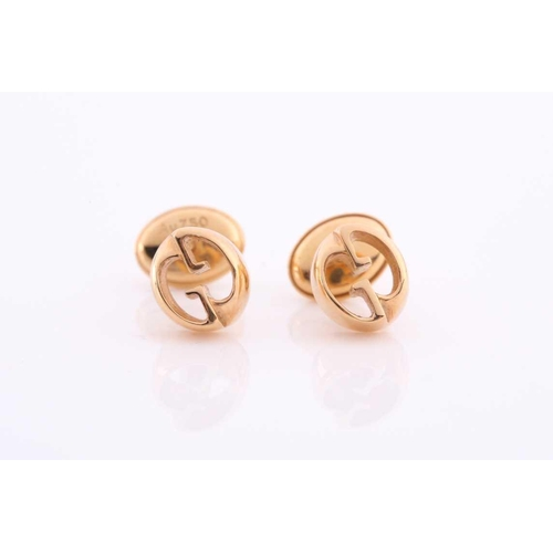 37 - Gucci. A pair of 18ct yellow gold stud earrings of double G design, in original box and outer box.Co...