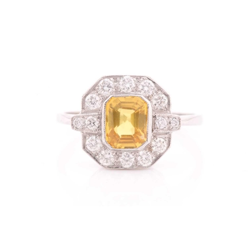 38 - A platinum, diamond, and sapphire ring, set with an emerald-cut sapphire of approximately 1.50 carat...