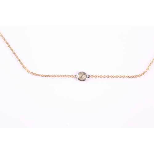 39 - An 18ct yellow gold and diamond necklace, the chain set with a collet-mounted round brilliant-cut di...