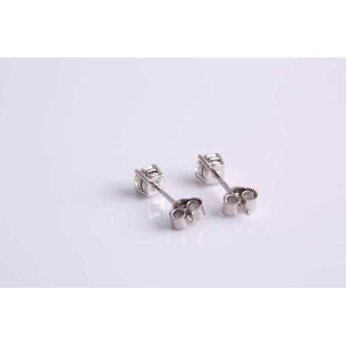 4 - A pair of platinum and diamond ear studs, the round brilliant-cut diamonds of approximately 0.45 car...