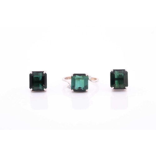 40 - An 18ct white gold, diamond, and synthetic green gemstone ring, size M, together with a pair of 18ct...