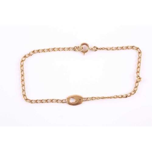 41 - An 18ct yellow gold bracelet, with a small oval pendant loop inset with a small white stone, 18 cm l...