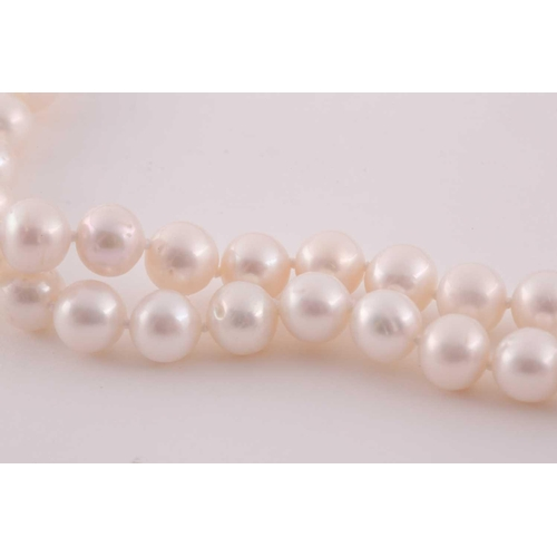 42 - A cultured pearl necklace, comprised of freshwater pearls of approximately 8-9 mm diameter, the neck...