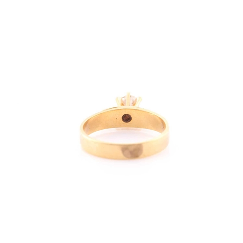 44 - An 18ct yellow gold and diamond ring, set with a round brilliant-cut diamond of approximately 0.40 c...