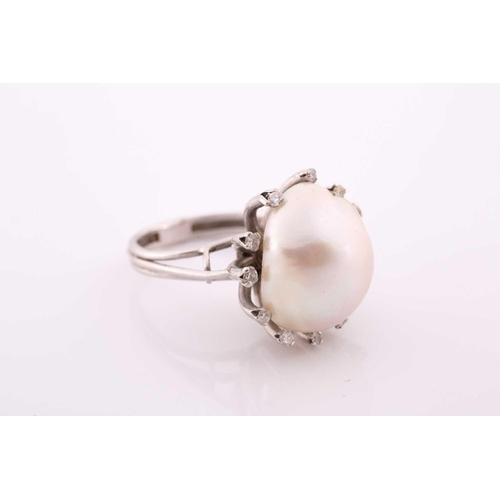 49 - A diamond and cultured Baroque pearl cocktail ring, the pearl measuring approximately 1. 7x 1.35, ra...