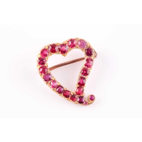 50 - A yellow metal and red spinel heart-shaped brooch, set with mixed-cut red spinels, unmarked, 2.2 x 1...