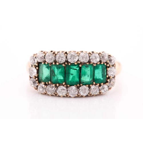 51 - An emerald and diamond three row ring, set with a central line of slightly graduated emerald-cut eme...