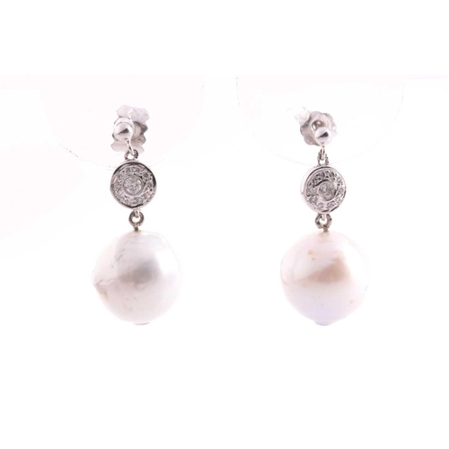 52 - A pair of white gold, diamond, and pearl drop earrings, set with South Sea pearls, approximately 10....
