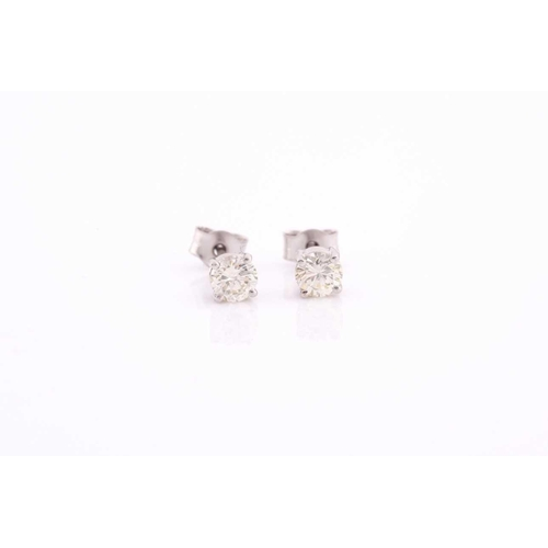 56 - A pair of platinum and diamond earrings, the round brilliant-cut diamonds of approximately 0.67 cara...