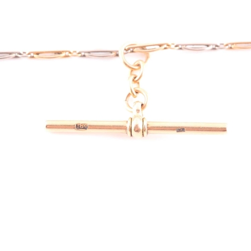 6 - An 18ct gold and platinum watch chain / choker necklace, alternating links, fitted with a T-bar pend...
