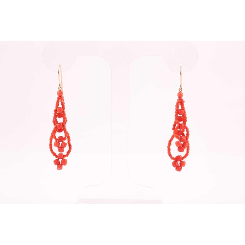 9 - A pair of yellow metal and coral beaded earrings, the coral beads strung into two strands, approxima...