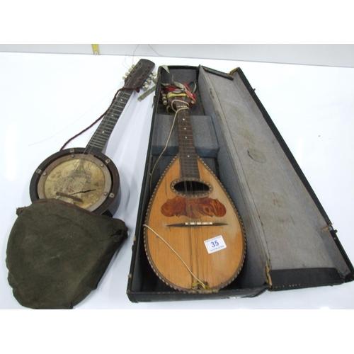 35 - Old banjo & mandolin in a cases A/F...