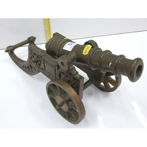 58 - heavy brass cannon...