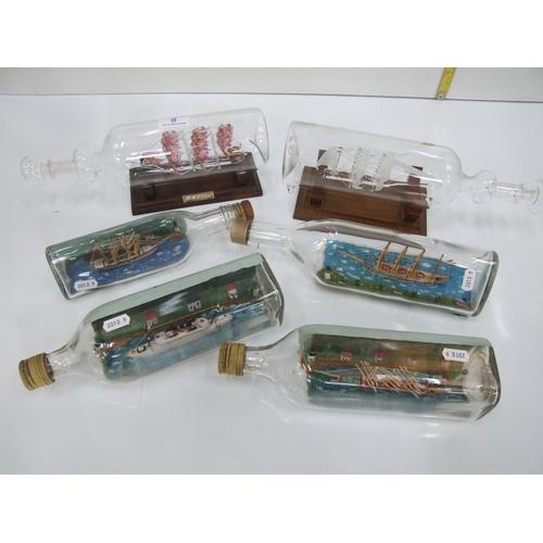 9 - 6 ships in bottles...