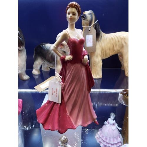 23 - A Coalport Ladies of fashion figurine 'Elizabeth' modelled by Jack Glynn...