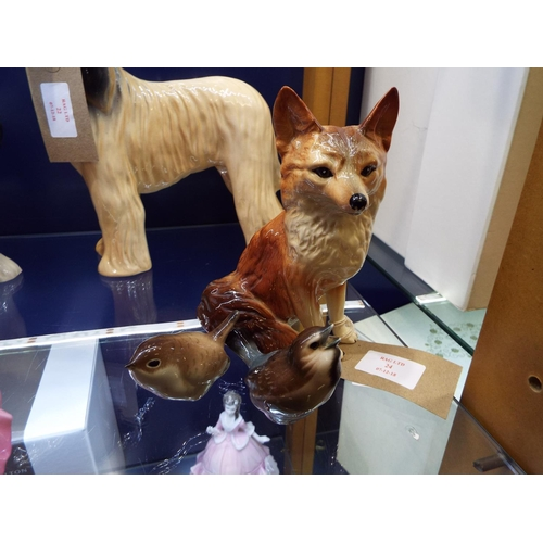 24 - A Goebels figure of a sparrow, a USSR wren and a Beswick style model of a fox...