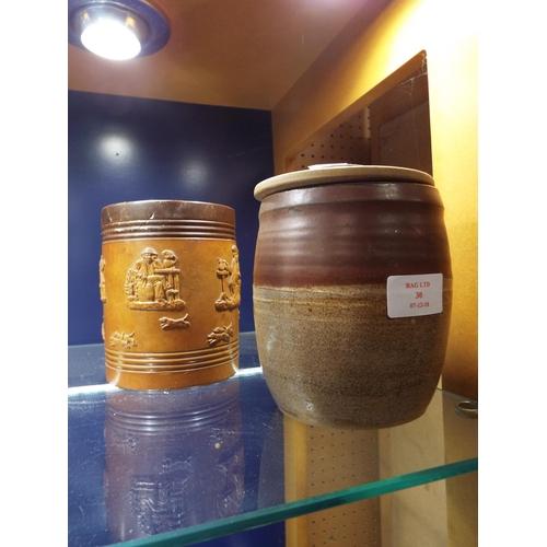 30 - A Studio pottery tea jar and a Royal Doulton tea jar...