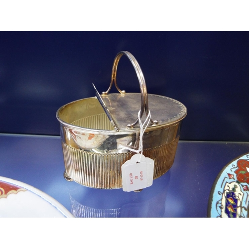 39 - A Victorian silver-plated spoon warmer having engraved decoration with ribbed body resting on four b...